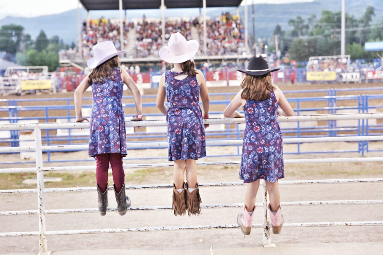 Three little girls enjoy the rodeo at Howelsen Hill Rodeo Grounds.