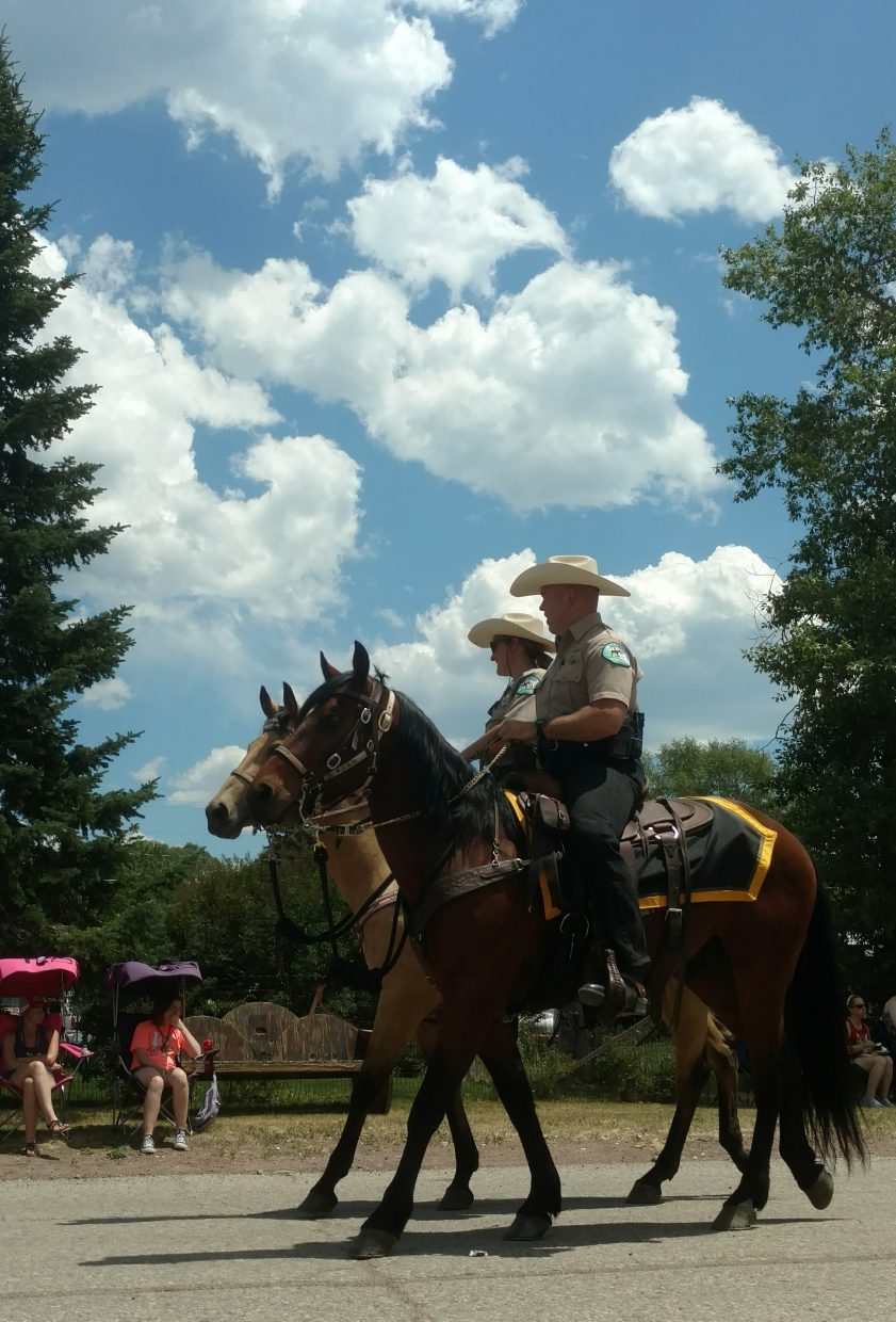 Mounted officers march in the Fourth of July parade in Steamboat Springs.