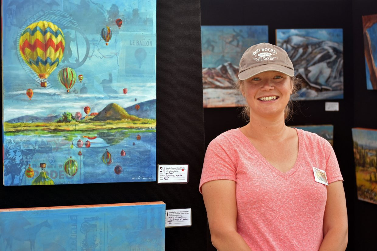 Artist Amelia Furman poses in front of her Steamboat-themed collages. Furman lives in Loveland, but is inspired by sights in the Steamboat Springs area.