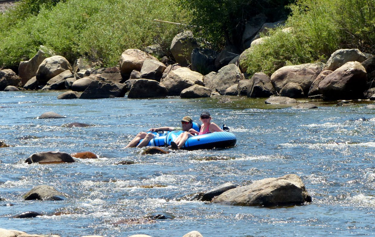 Two tubers float down the Yampa River.