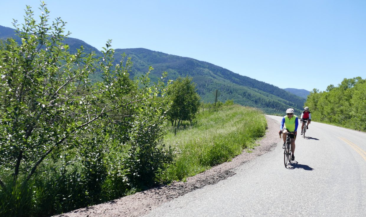 Cyclists riding the road at Lake Catamount.