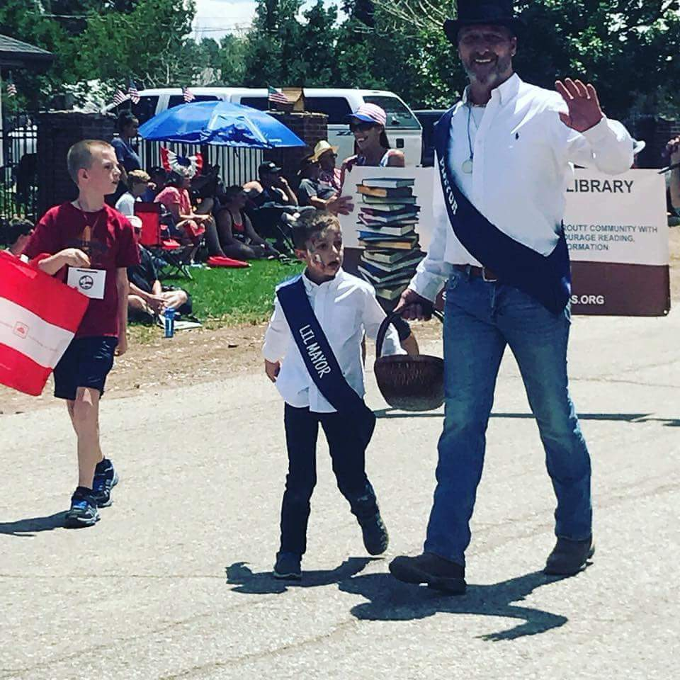 Yampa's new mayor walks in the Fourth of July parade in Yampa.
