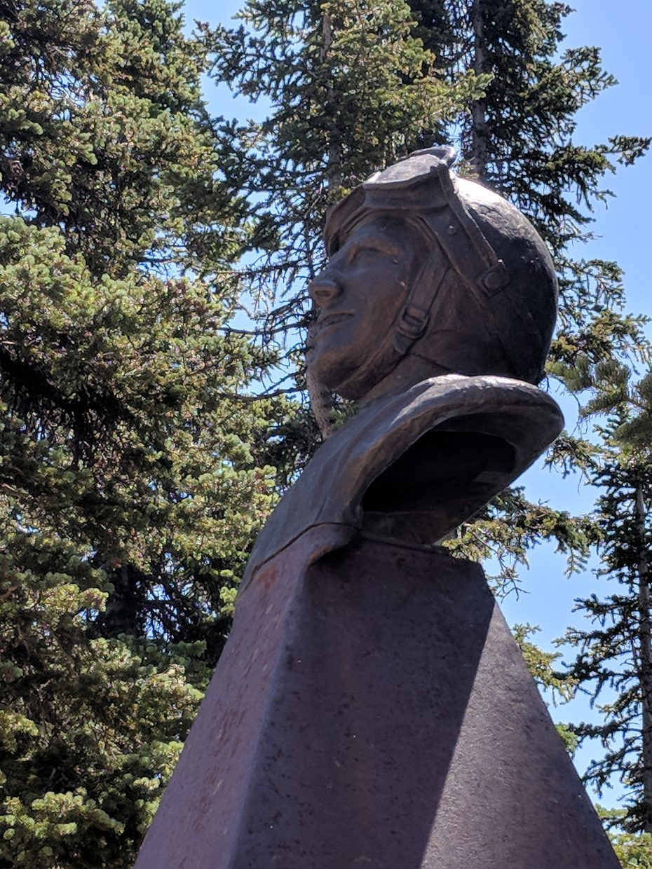 A statue sits at the top of Mount Werner.