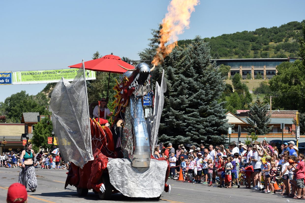 Spike the dragon blows flames down Lincoln Avenue during Steamboat's Fourth of July parade Wednesday morning.