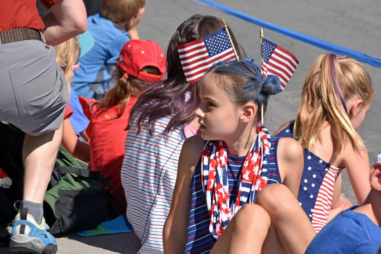 A child looks toward her family during Steamboat's Fourth of July parade Wednesday morning.