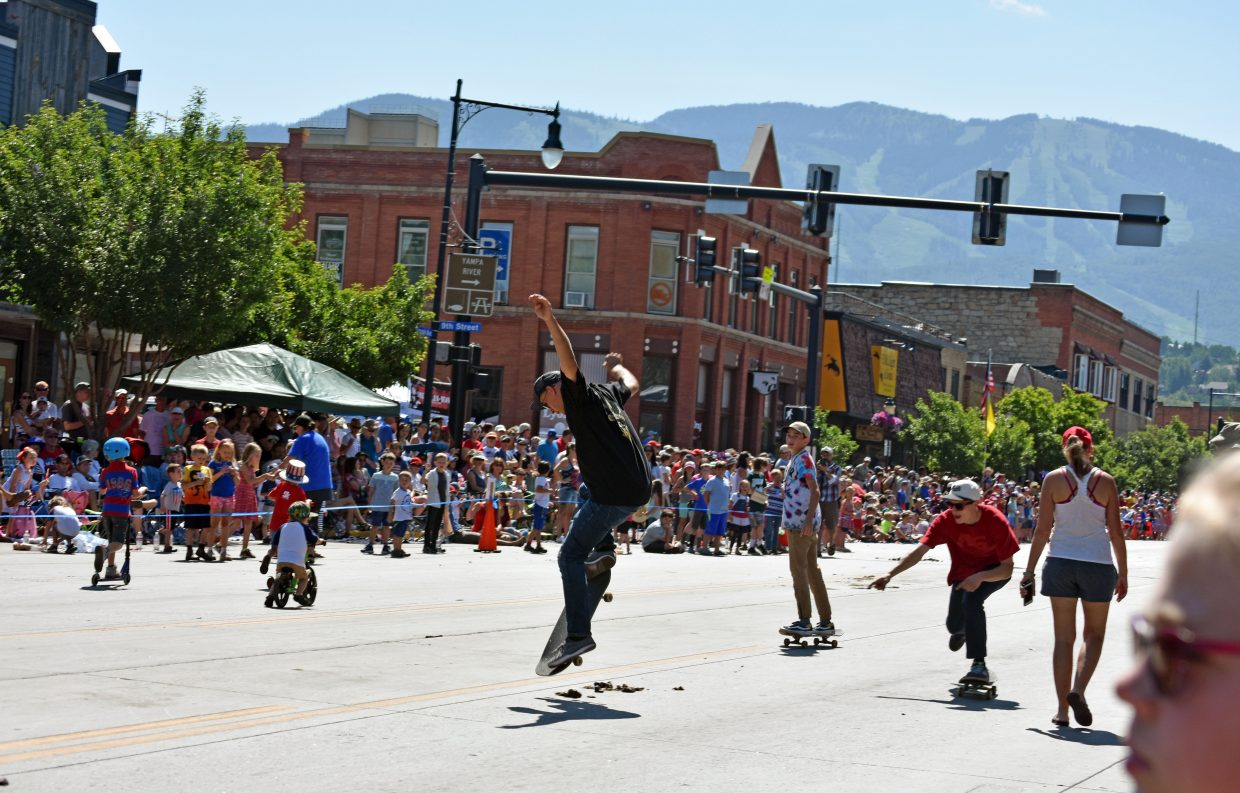 A member of the Steamboat Sk8 Church gets some air on Lincoln Avenue during Steamboat's Fourth of July parade Wednesday morning.