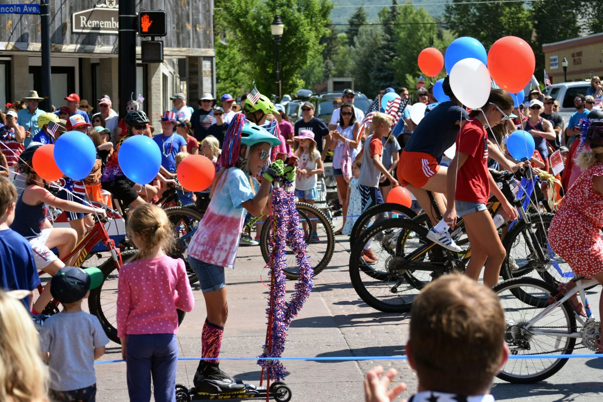 Steamboat Springs Winter Sports Club athletes made their way down Lincoln Avenue on roller skis, bikes and scooters during Steamboat's Fourth of July parade Wednesday morning.