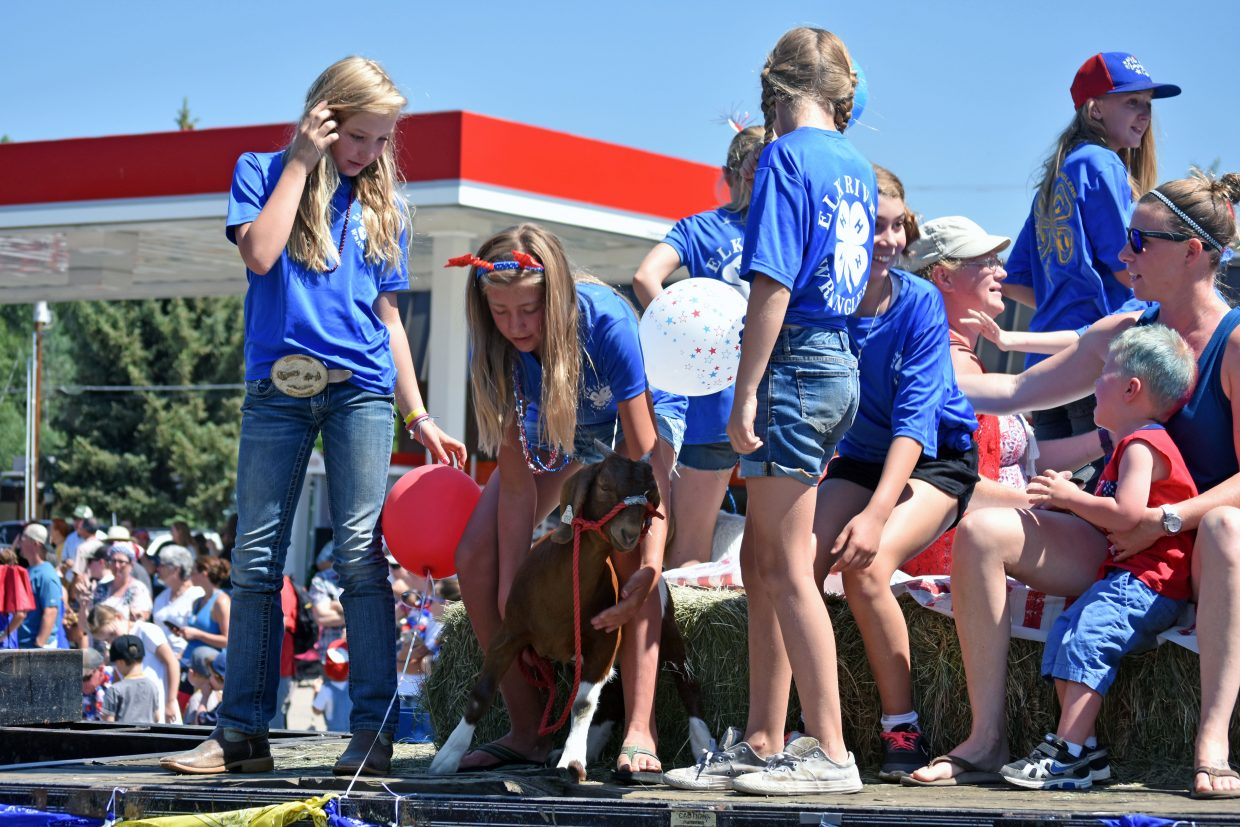 Members of the Elk River Wranglers 4-H Club wrangle a goat after a sudden stop during Steamboat's Fourth of July parade Wednesday morning.