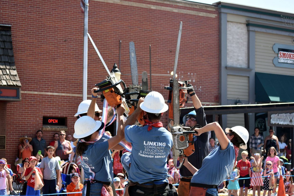 Rocky Mountain Youth Corps' chain saw crew performs a choreographed routine at Steamboat's Fourth of July parade Wednesday morning.
