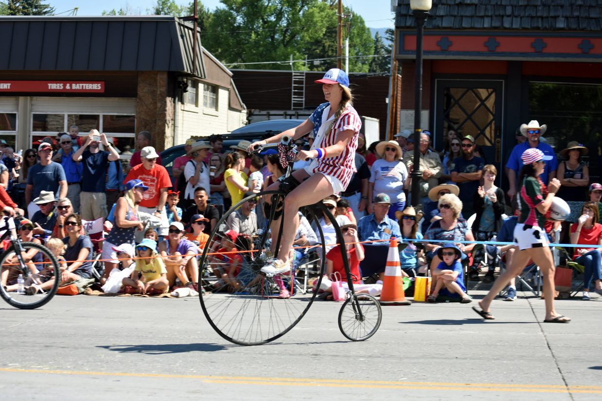 A member of the Steamboat Rugby Club rides a high-wheel bicycle during Steamboat's Fourth of July parade Wednesday morning.