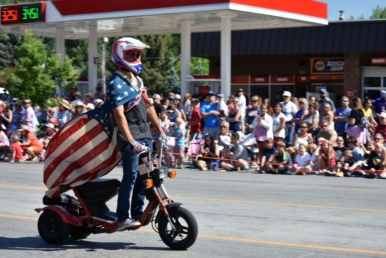 A person rides a three-wheeled scooter down Lincoln Avenue as part of Steamboat's Fourth of July parade Wednesday morning.