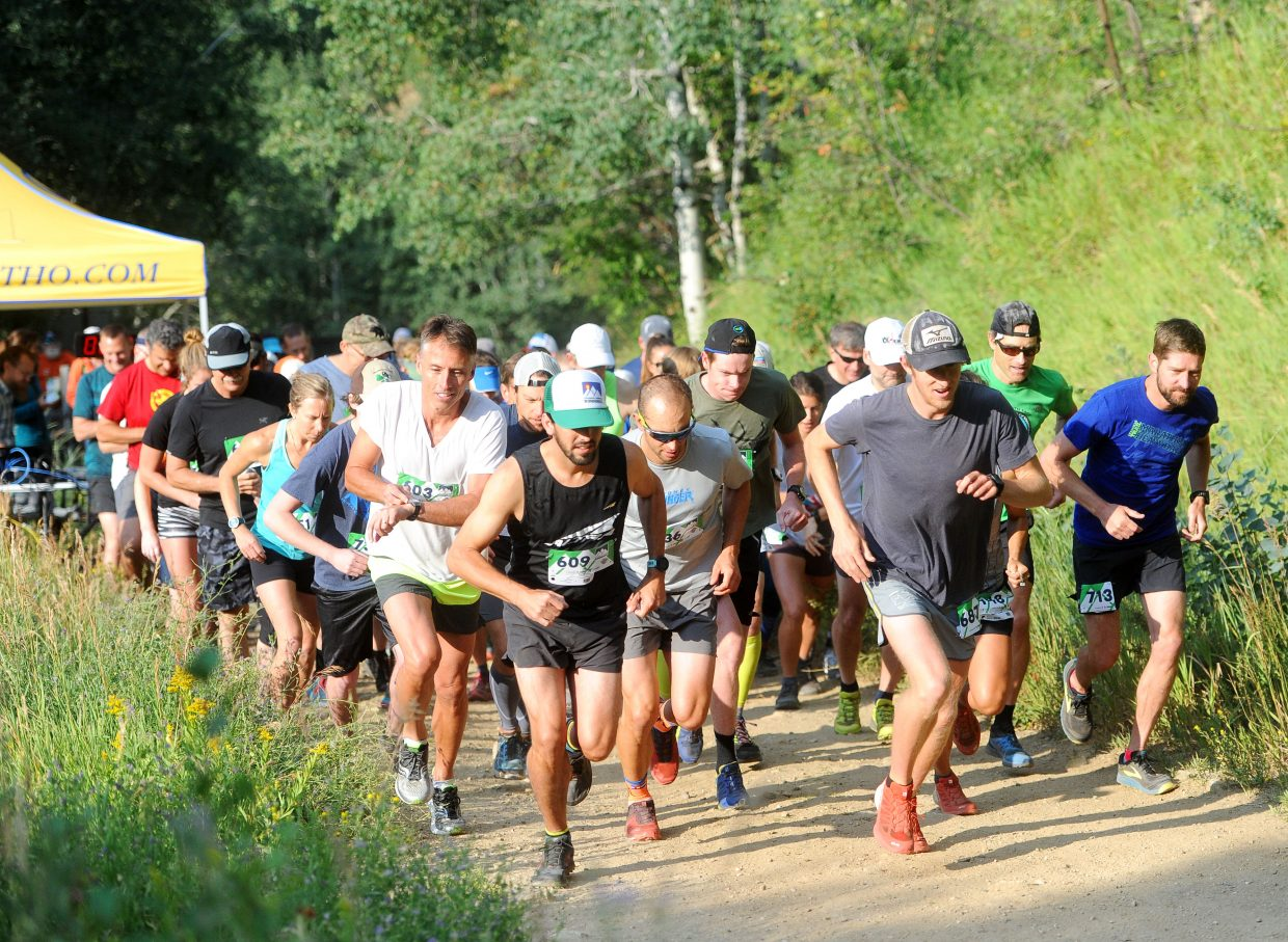 Runners take off for the 9.5-mile run in the Steamboat Springs Running Series Spring Creek Memorial run on July 28.
