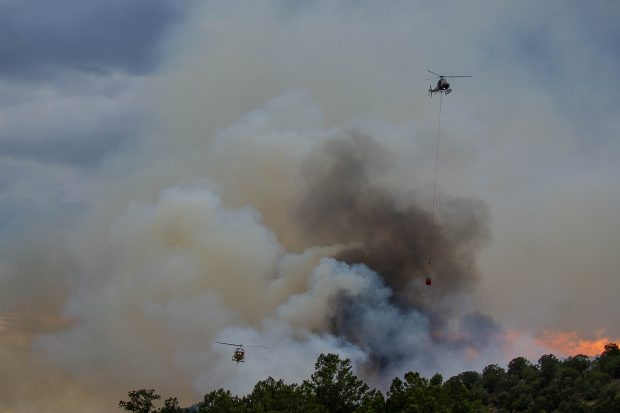 Air crews worked the fire into the evening Tuesday night near Basalt.