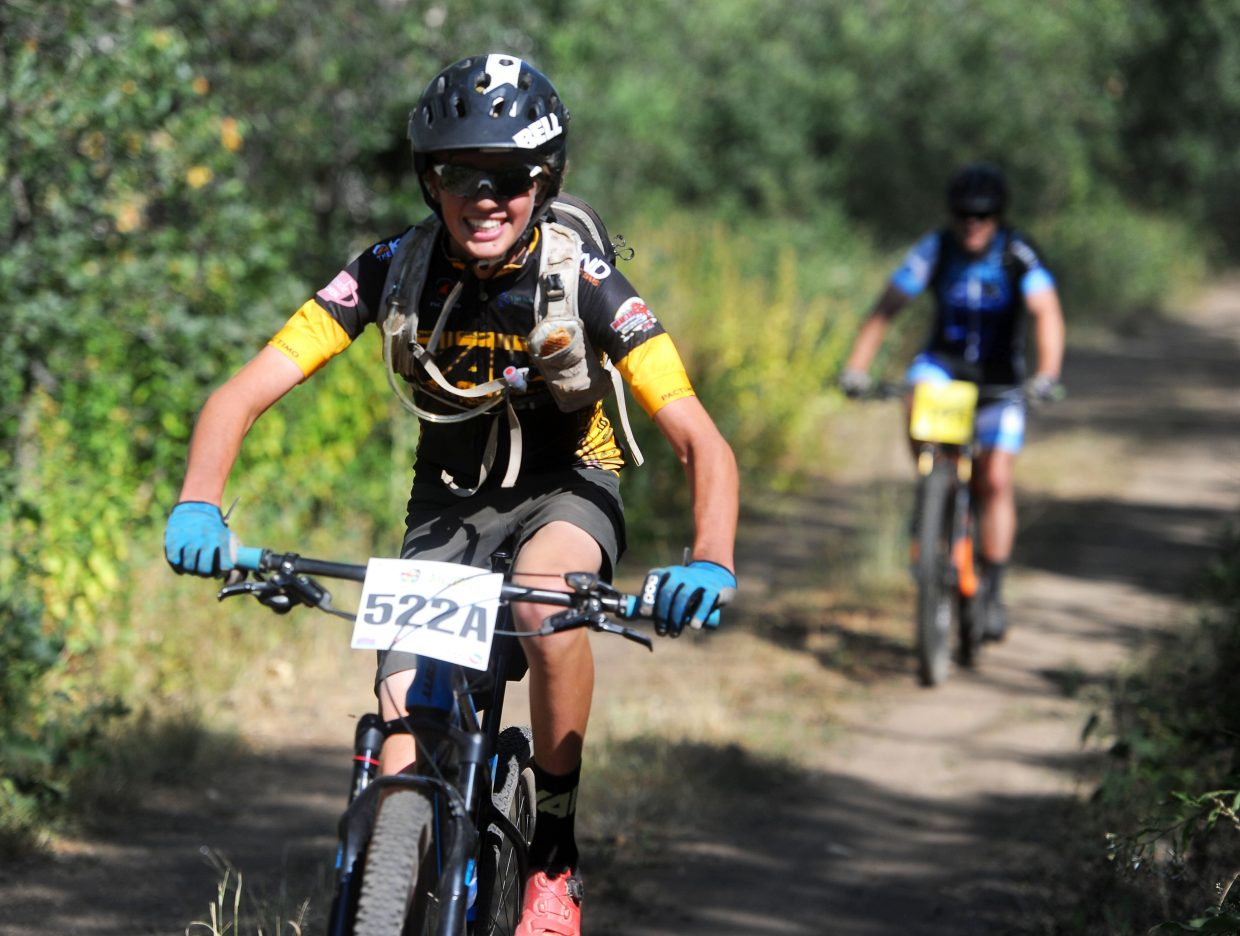 Aidan Duffy cruises down the top of Ridge Trail at the Steamboat Stinger on Saturday, Aug. 11.