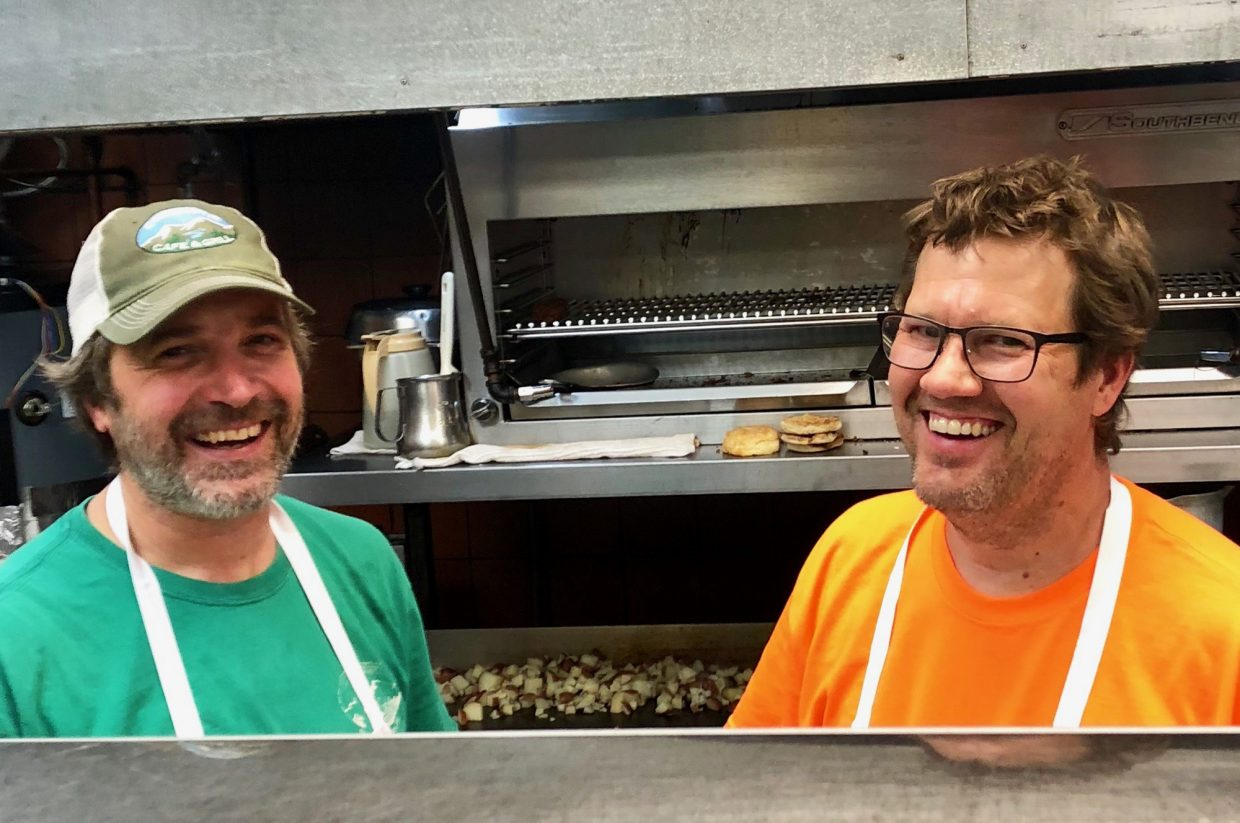 Jason Landers in the kitchen of the Creekside Cafe & Grill with new owner Rex Brice.