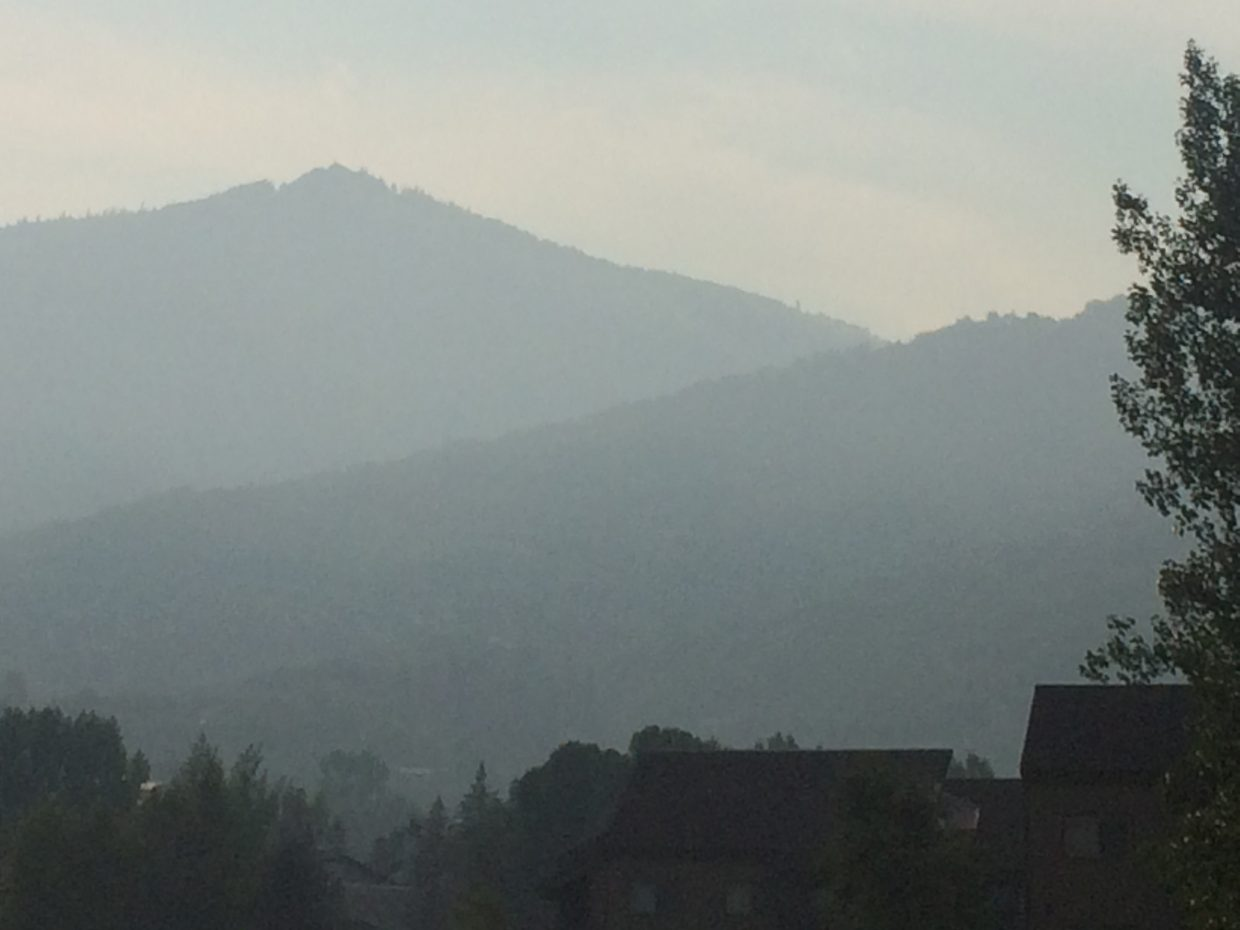 Haze covers the Mount Werner from view as smoke from Northern California wildfires flows into the Yampa Valley.