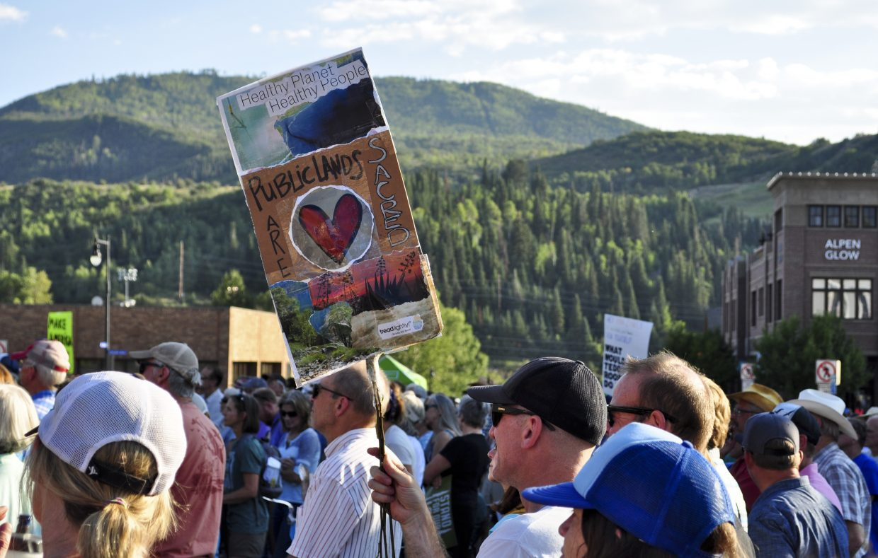 Protesters gather near the Routt County Courthouse  in Steamboat Springs on Friday to celebrate public lands and demonstrate against U.S. Secretary of the Interior Ryan Zinke's policies.