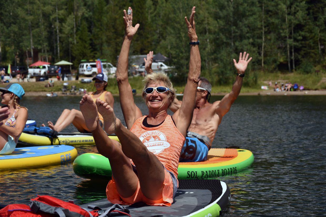 Kirsten Ames leads paddleboard yoga at the Pearl Lake Festival on Saturday.