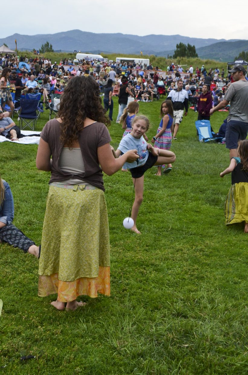 Jaime Dulberg, left, and Anna Sims spin poi at the free concert.