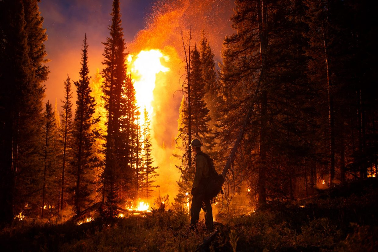 Wyoming Interagency and Tatanka Hotshots conduct a firing operation Aug. 16 on the Silver Creek Fire, which has burned more than 4,700 acres in Routt National Forest. The crews worked to eliminate fuels between the containment line and the fire's edge.