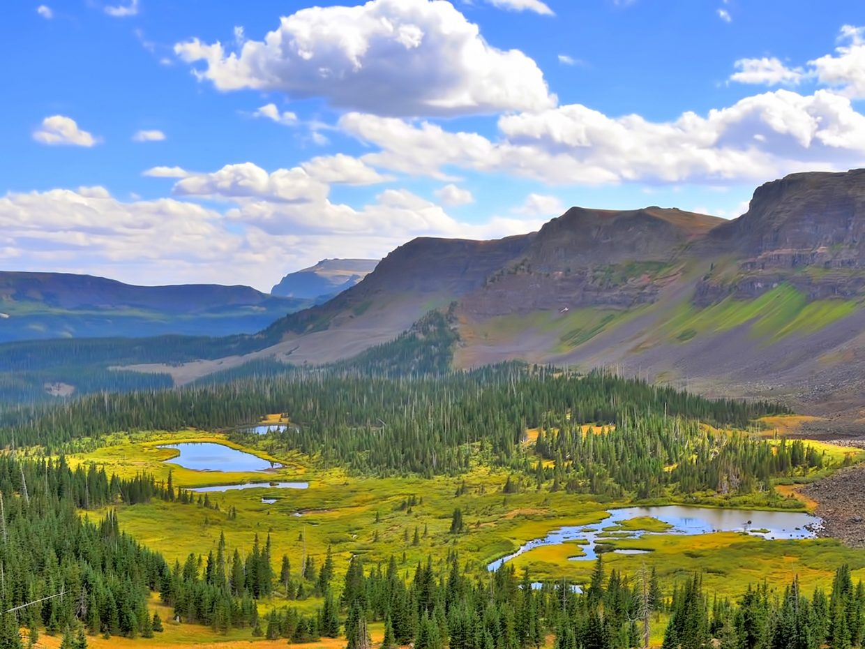 Summer skies still permeate at Mandall Lake in the Flat Tops Wilderness Area.