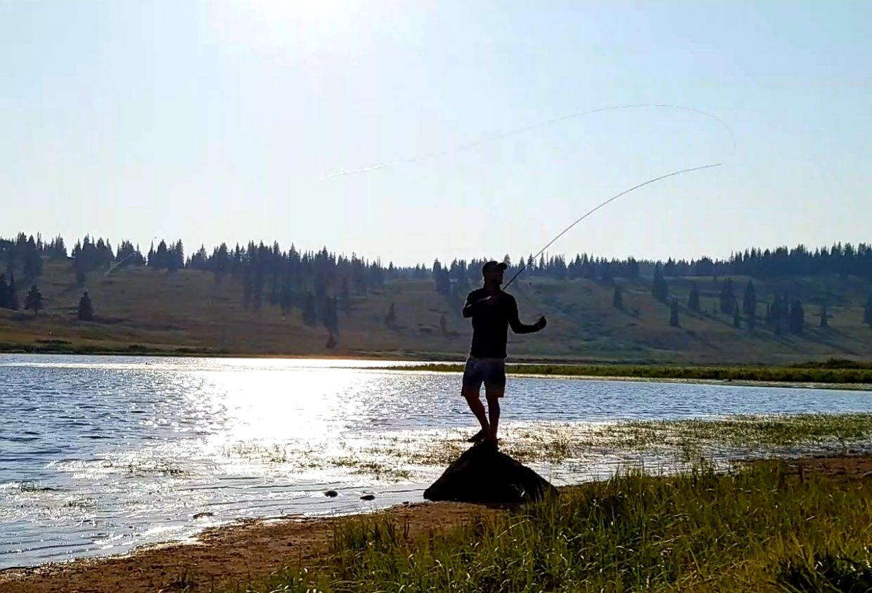A man fishes at a lake.