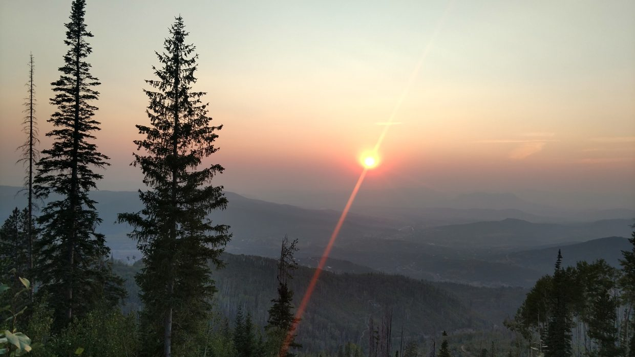 The sun sets among the smoky haze, blowing in from area and California wildfires.