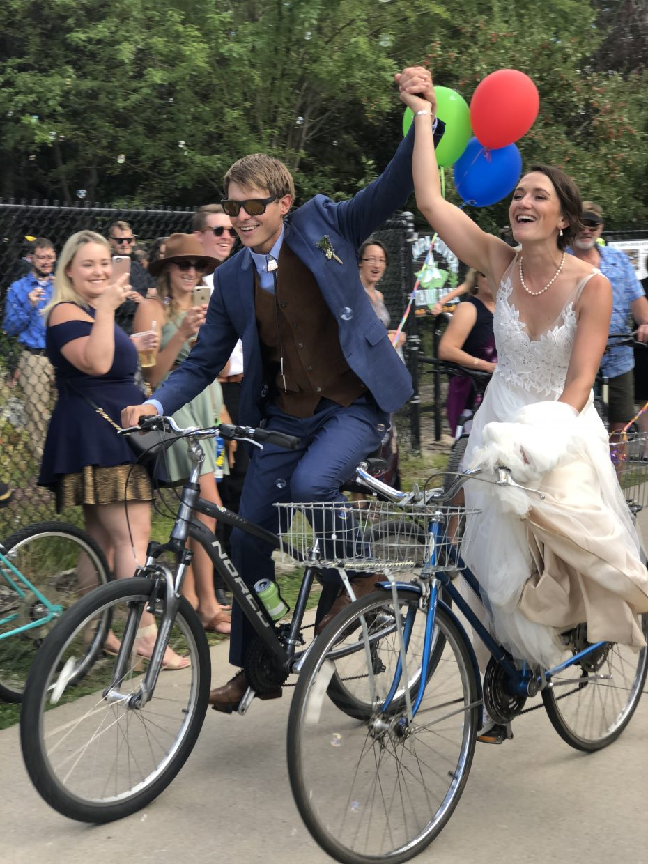 Ben and Sarah Glassmeyer take their inaugural bike ride as husband and wife on the Yampa River Core Trail.