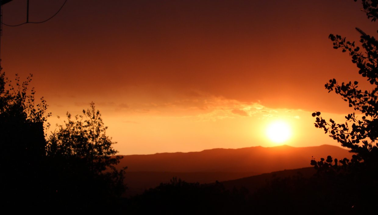 Sunset with rumbling thunder.