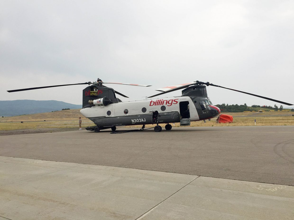 A Chinook helicopter sits at Steamboat Springs Airport to help with fighting the Silver Creek Fire.