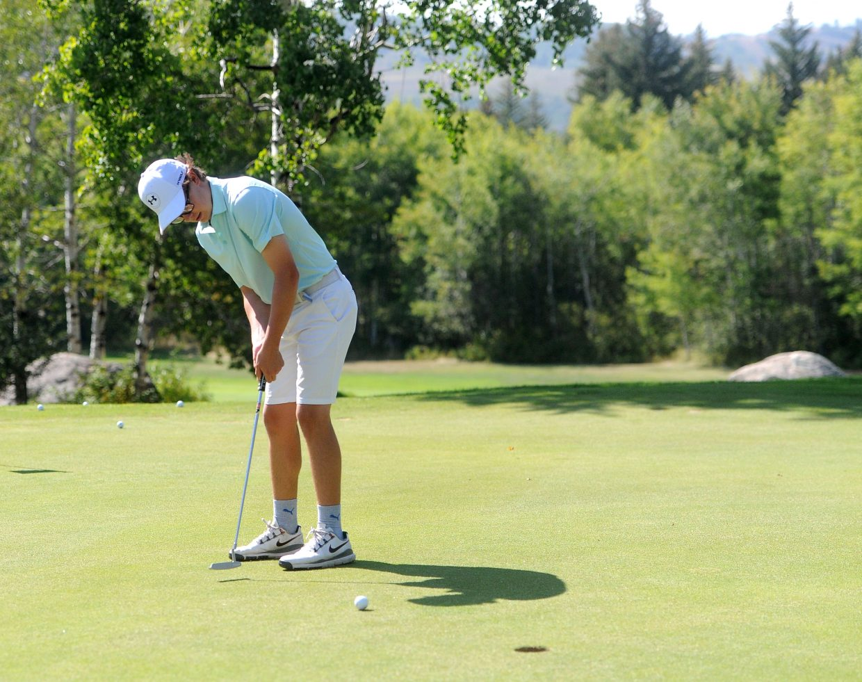 Steamboat Springs High School junior Tommy Henninger lines up a putt at practice at Rollingstone Ranch Golf Course on Aug. 29. Henninger has found recent success, placing second individually at the Rifle Bears Invitational on Aug. 28 in Rifle, which helped the team win first overall.