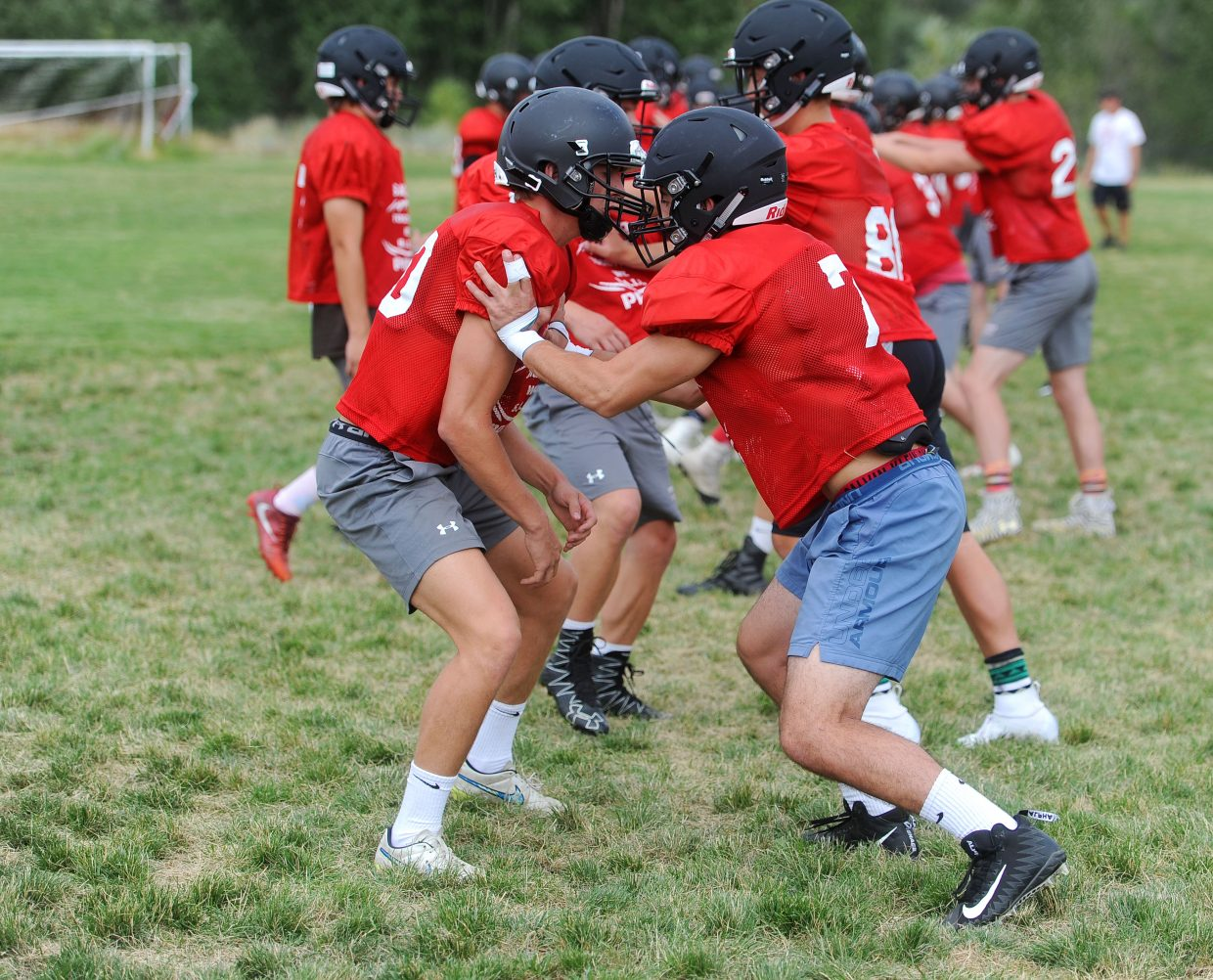 Steamboat Sailors seniors Tyden Baker, left, and Ford Louden work on their blocking skills during football practice on Tuesday, Aug. 14.