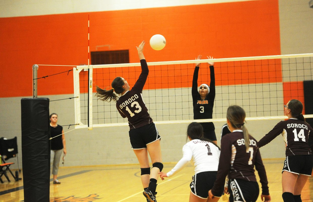 Hayden junior Joey Deckler attempts to block a swing from Soroco junior Tyla Johnson at the net on Aug. 28.
