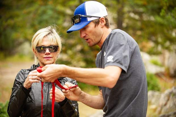 Aspen Alpine Guide Nate Rowland shows Debbie Stonecipher how to tie a water knot with webbing on August 25 for a field planning and safety clinic.