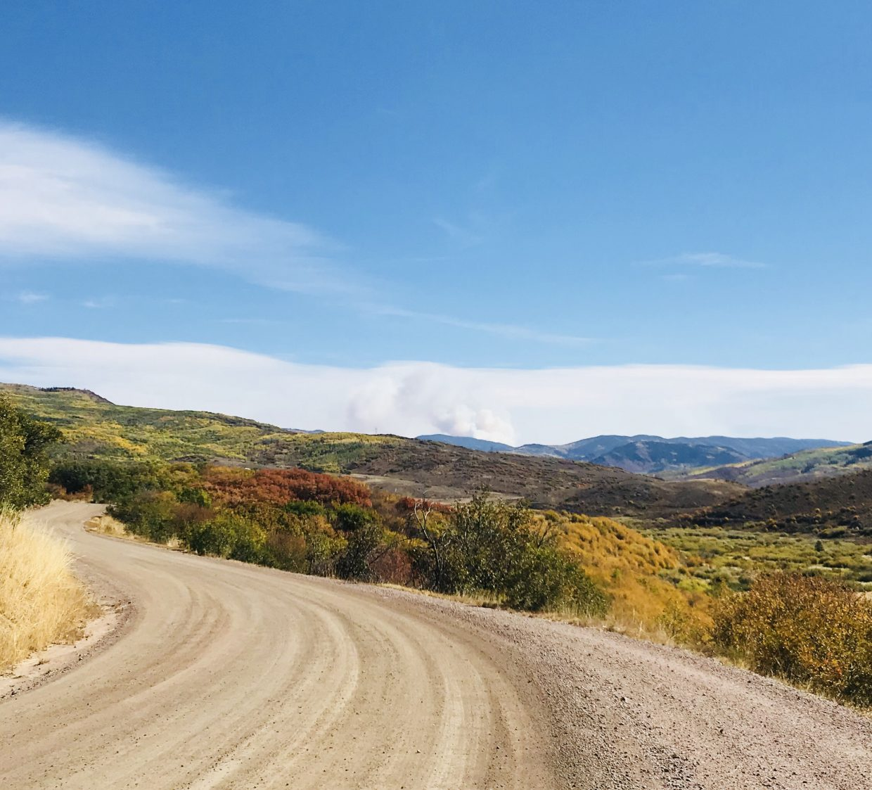 Fall colors and Silver Creek fire from County Road 25 in Oak Creek.