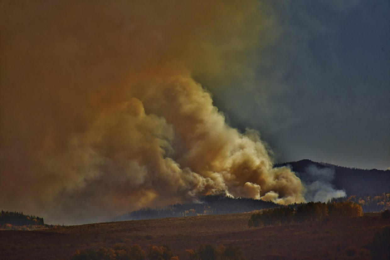 Smoke blows wildly from the Silver Creek Fire.