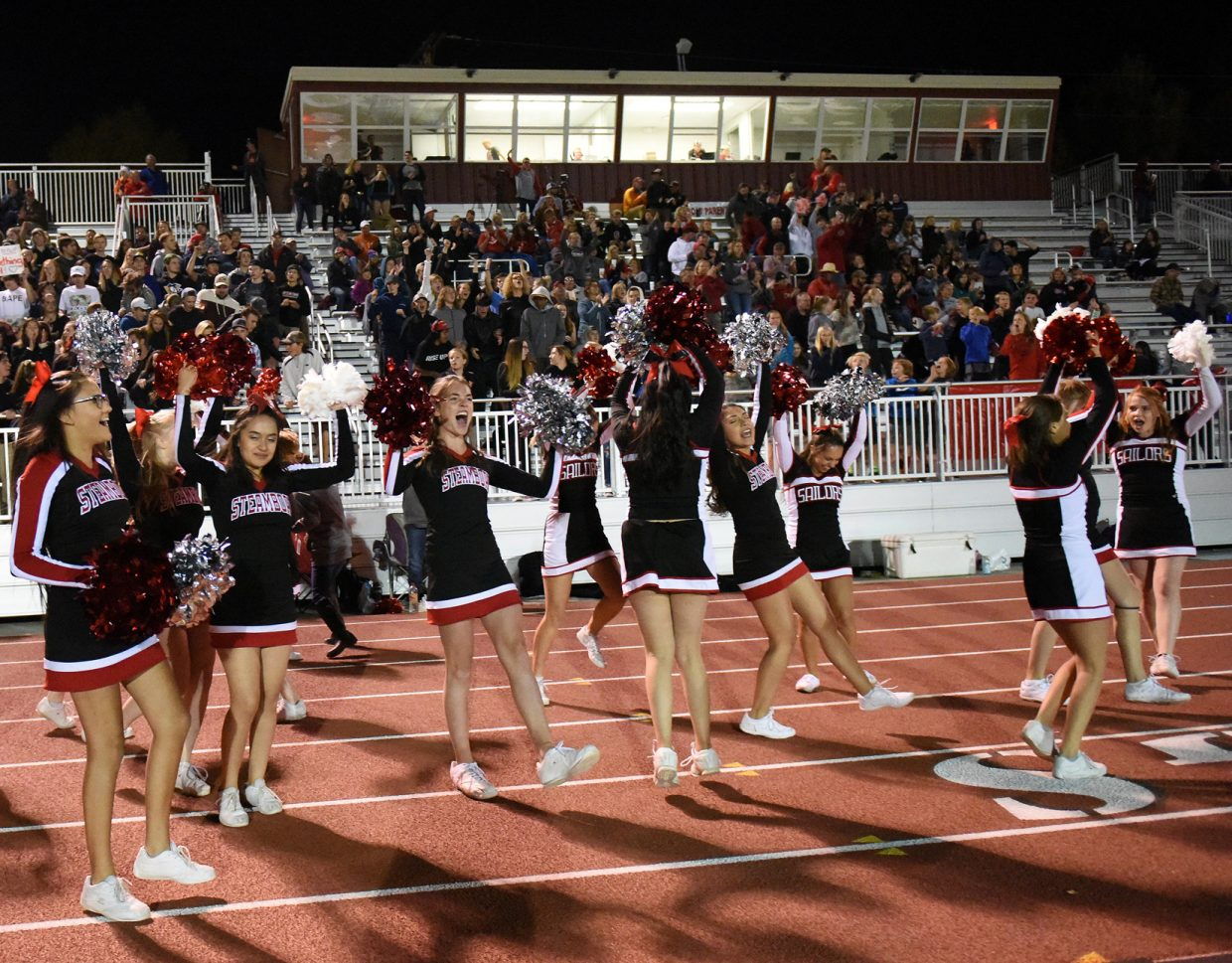 The Steamboat Springs High School cheerleading team celebrates the football team's 40-7 win against Hotchkiss on Friday night.