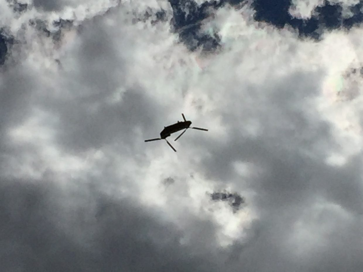 A helicopter assisting in the fires across Northwest Colorado flies over head.