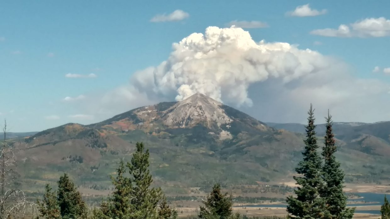 Smoke from the newest wildfire, the Ryan Fire, as seen from Sand Mountain, makes Hahn's Peak appear volcanic.