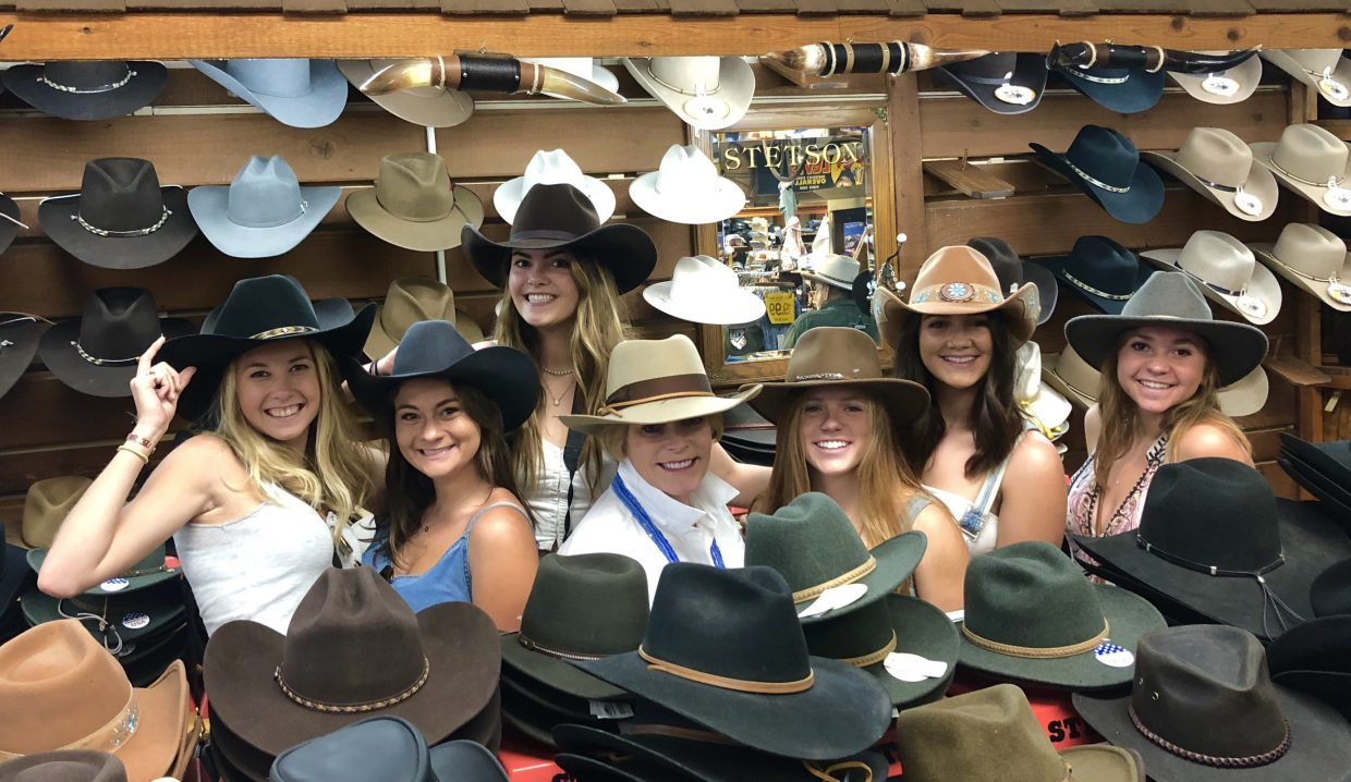 Women embrace their inner cowgirls with cowboy hats at F.M. Lights & Sons.