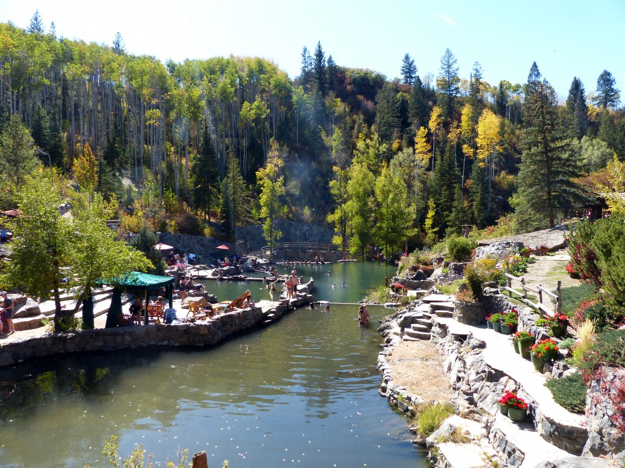 Strawberry Park Hot Springs stands surrounded by mostly evergreens on the first day of fall.