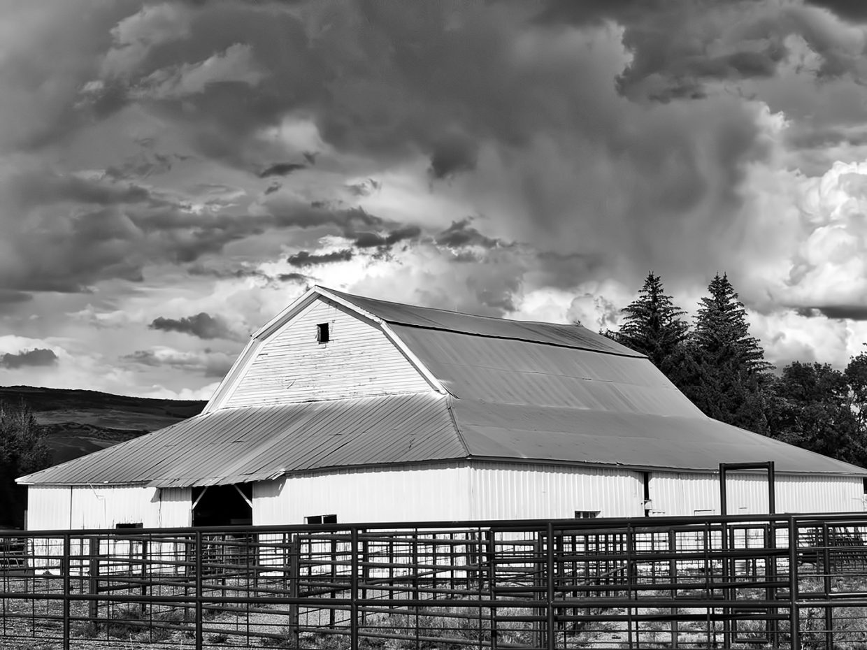 Storm clouds brew over the Carpenter Ranch barn.