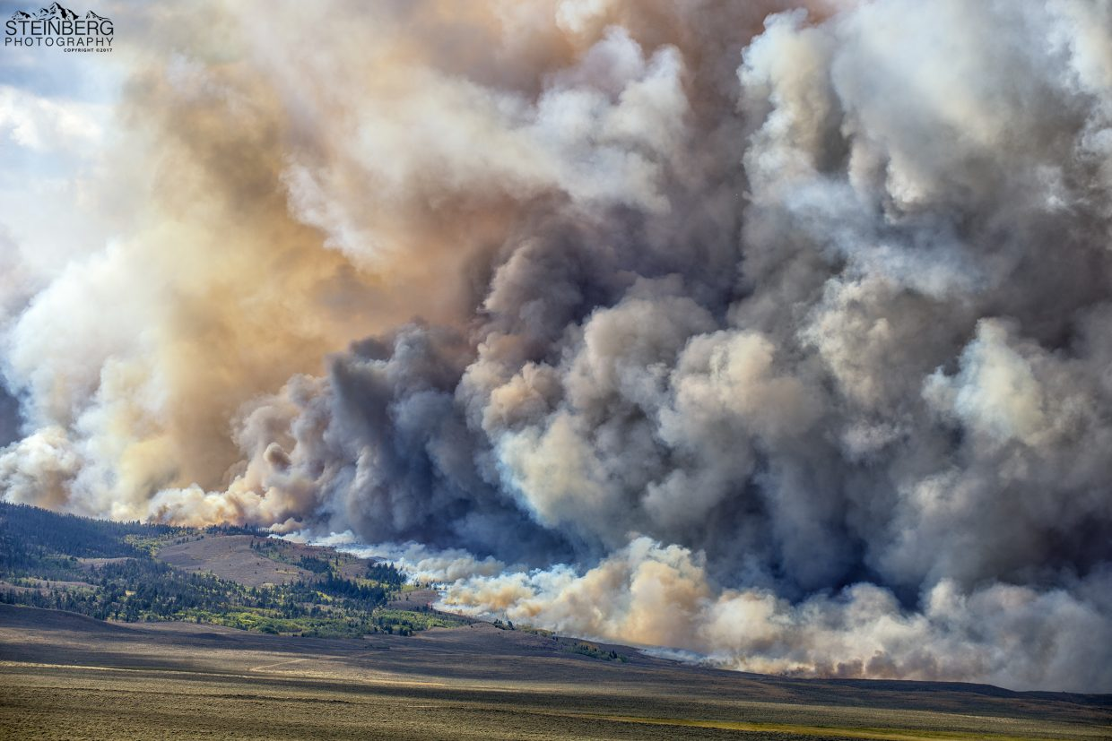 The Ryan Fire roars downhill toward Wyoming Highway 230 on Sept. 23.