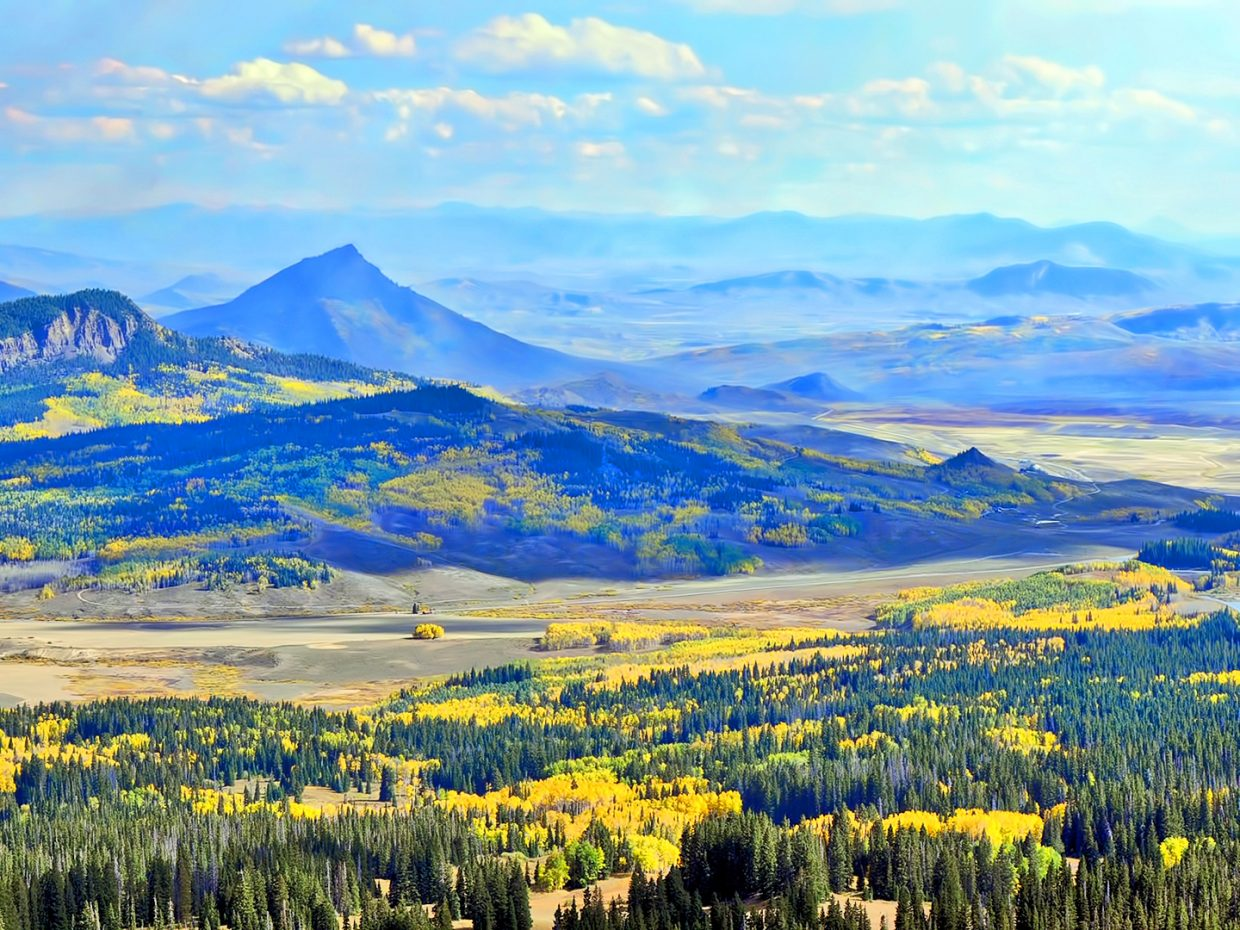 Gold starts to paint the valley where Whiteley Peak can be seen from Rabbit Ears Pass.