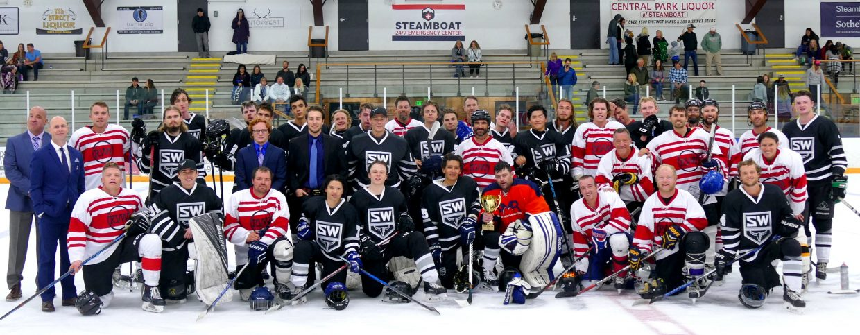 Steamboat Wranglers and Steamboat Adult League All-Stars pose for a group shot.
