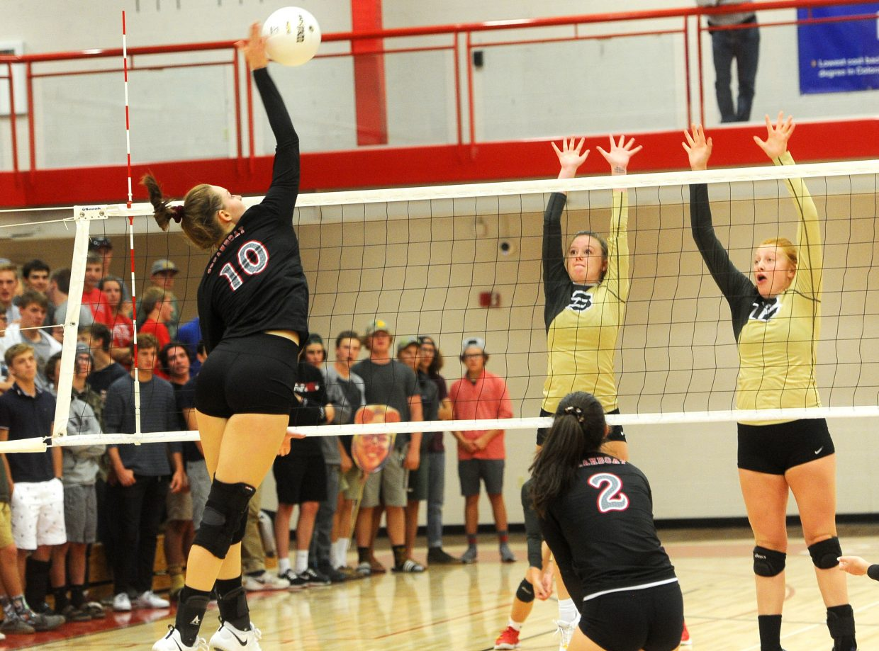 Steamboat senior Anna Allsberry delivers a kill against Battle Mountain at Steamboat Springs High School on Tuesday, Sept. 25.