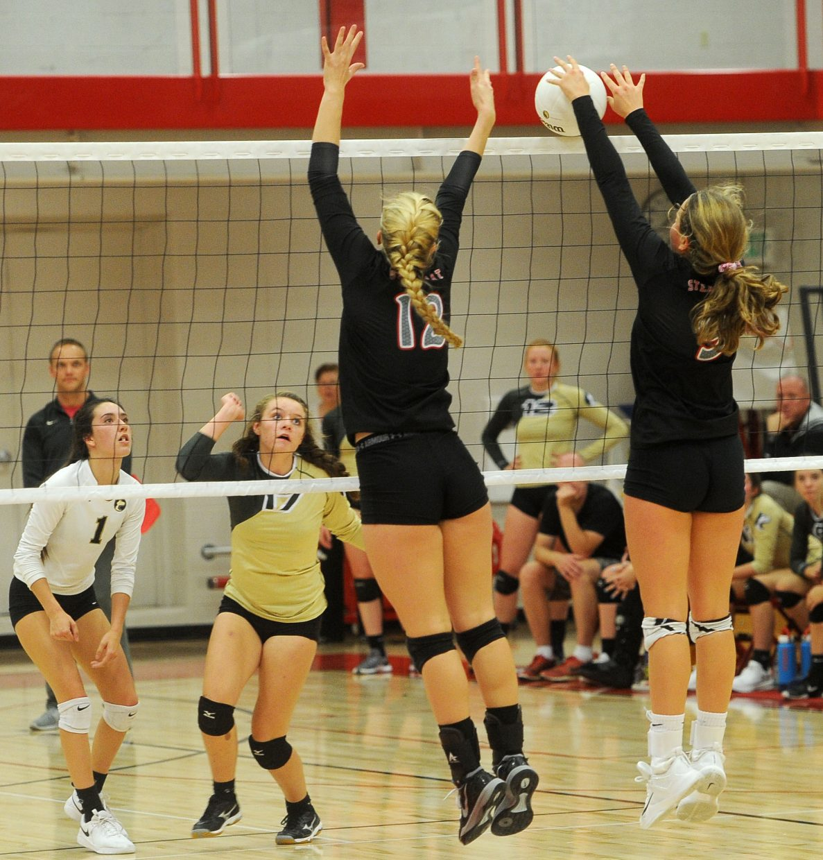 Seniors Avery Harrington and Abi Berlet line a block against Battle Mountain at Steamboat Springs High School on Tuesday, Sept. 25.