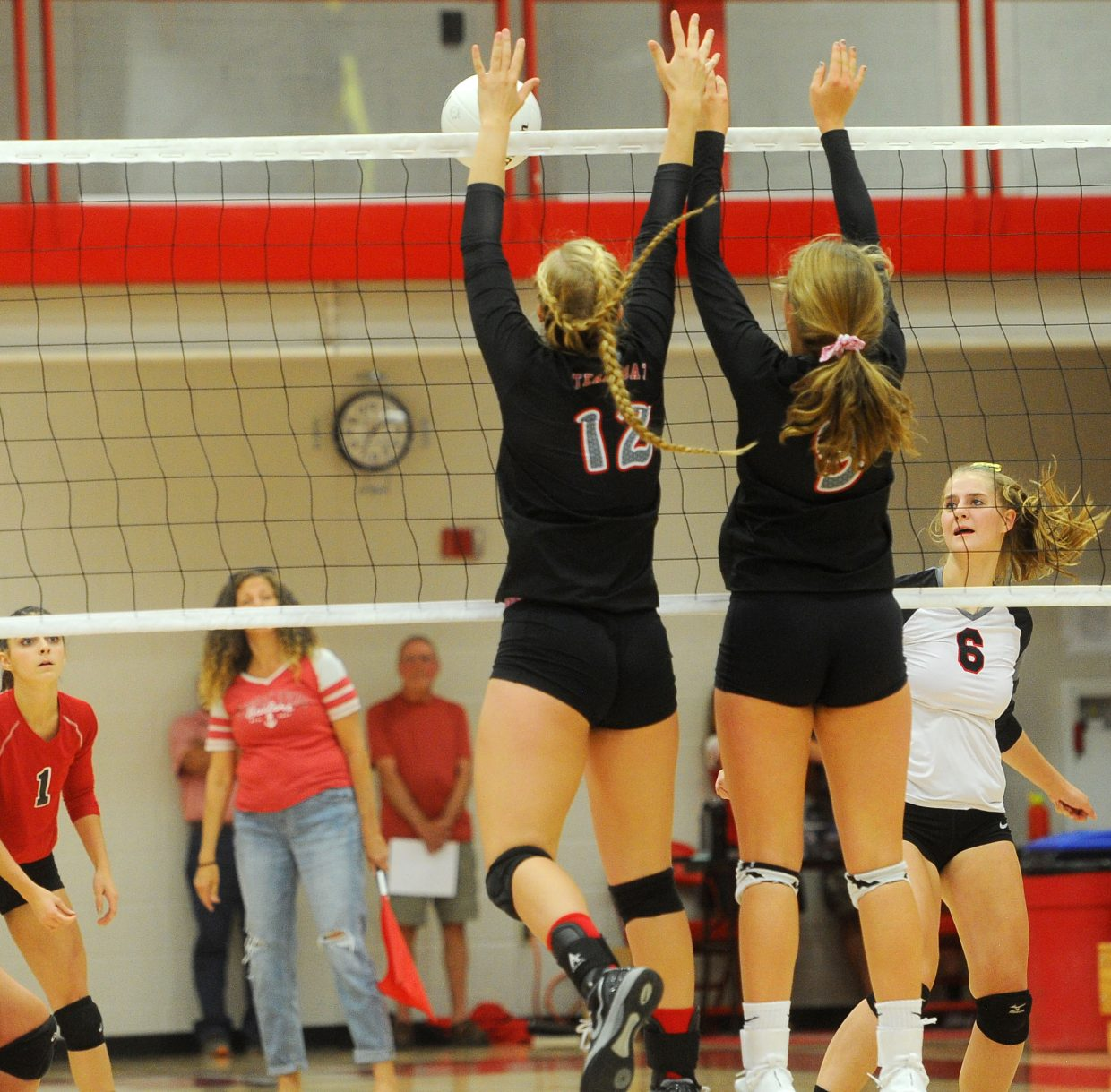 Steamboat Springs seniors Avery Harrington, left, and Abi Berlet block a hit in the match against Eagle Valley at Steamboat Springs High School on Sept. 13.