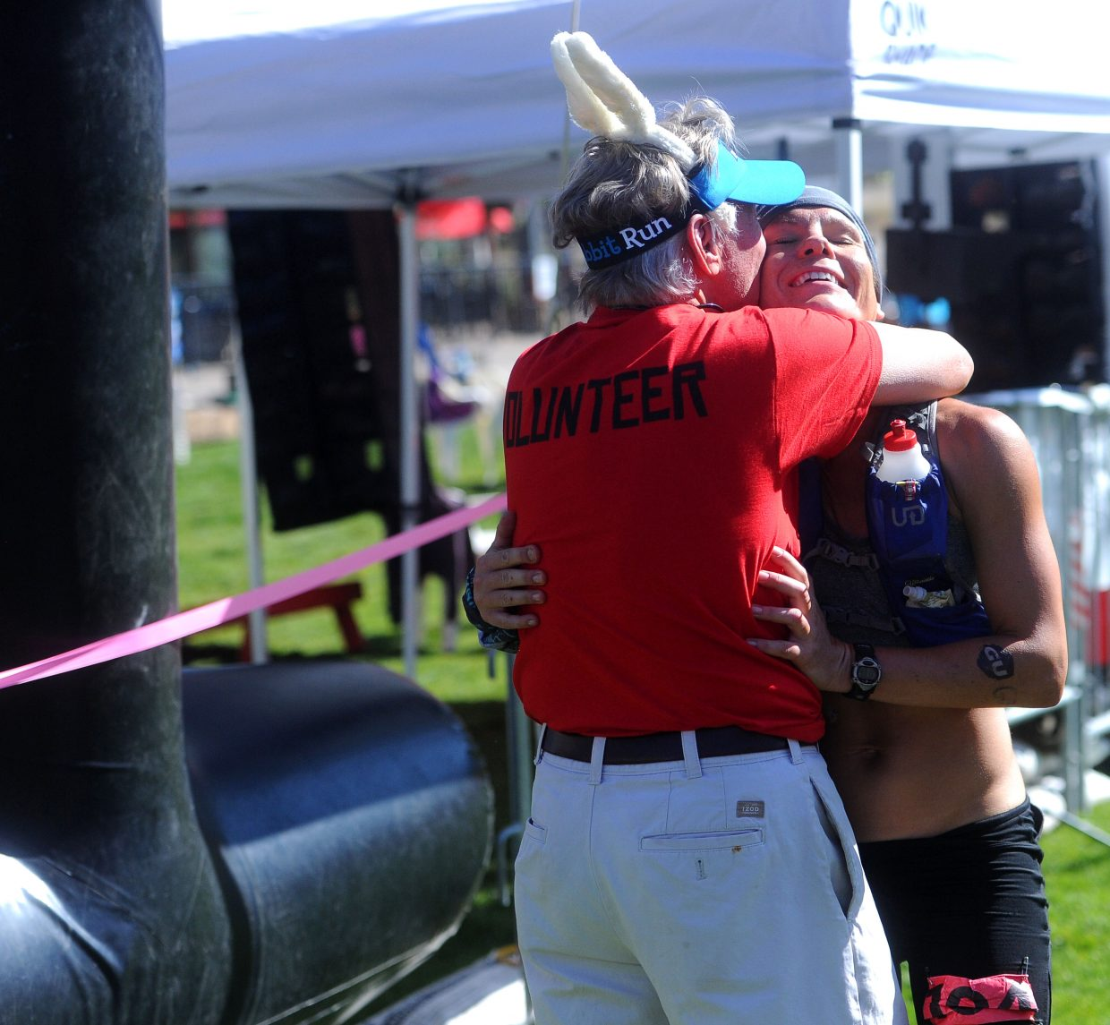 Michele Yates from Conifer embraces race director Fred Abramowitz after winning the hare division of the Steamboat Springs Run Rabbit Run 100-mile race on Saturday, Sept. 15.