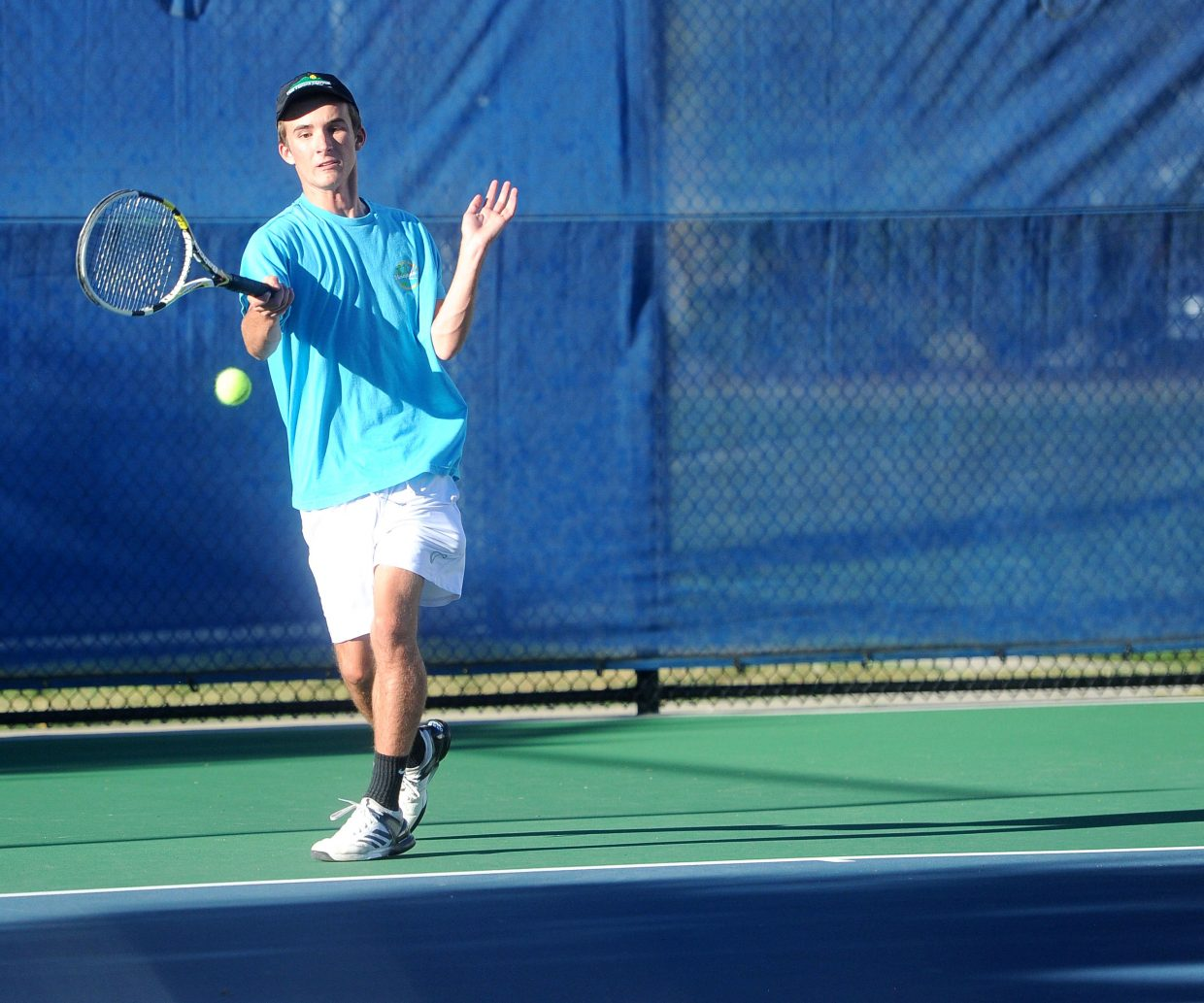 Ethan Paulus delivers a shot against Roy Lundeen in the challenge match for No. 2 singles on Wednesday, Sept. 12.